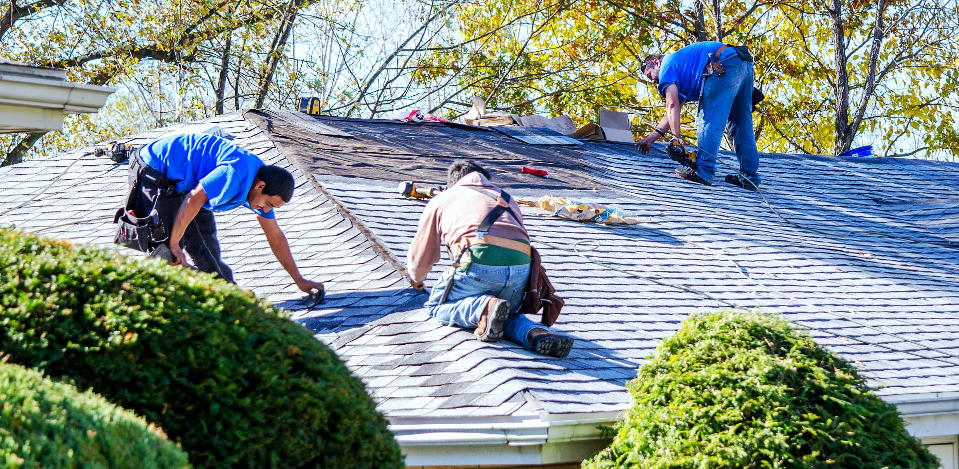 workers repairing the roof