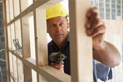 worker building timber frame